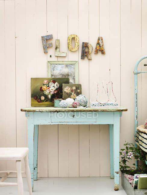 Vintage pastel colored table in country home — home interior ...