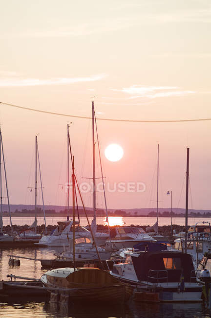 Front view of lots anchored yachts at sunset — Stock Photo