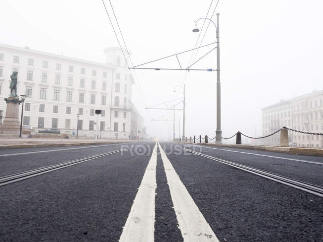 Surface view of marked road and misty street — Stock Photo