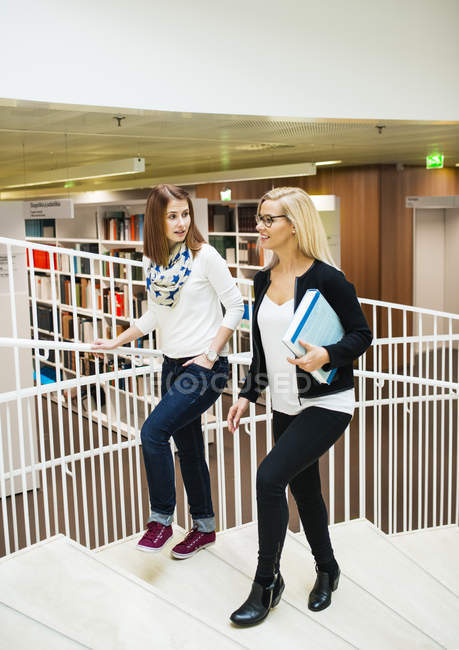 Two women walking up stairs, selective focus — Stock Photo