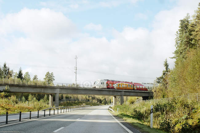 View of road and train moving on bridge — Stock Photo