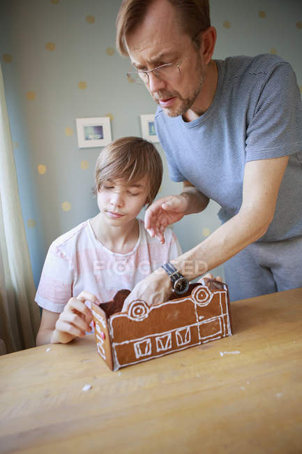Father and son making cookie bus, focus on foreground — Stock Photo