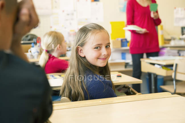 Portrait of smiling schoolgirl, focus on foreground — Stock Photo