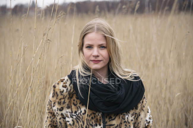 Portrait of young blonde woman in reeds — Stock Photo