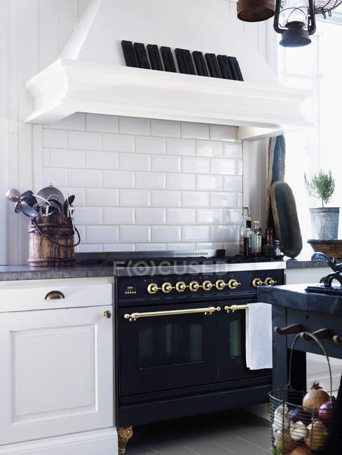 Vintage styled oven in kitchen interior — Stock Photo