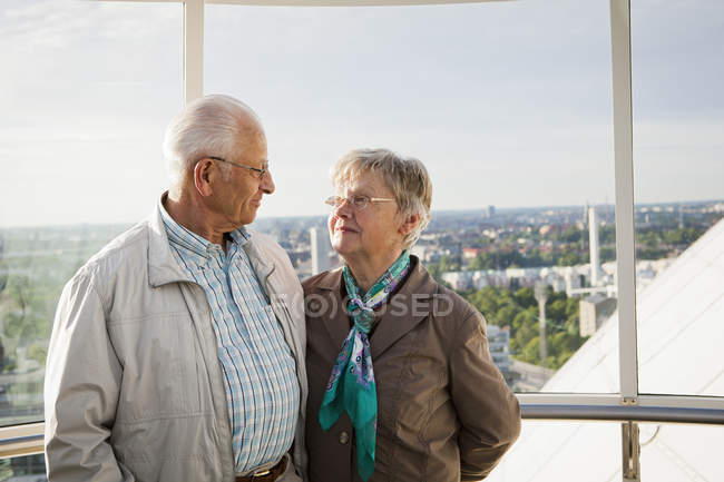 Senior couple looking at each other, focus on foreground — Stock Photo
