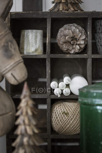 Winter decorations and candles on wooden shelves — Stock Photo