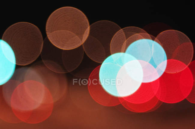 Blue and red spotted bokeh background — Stock Photo