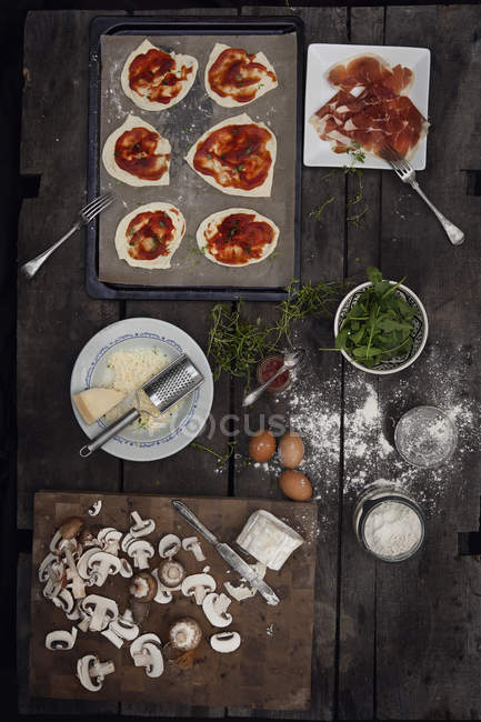 Elevated view of variation of pizzas ingredients — Stock Photo