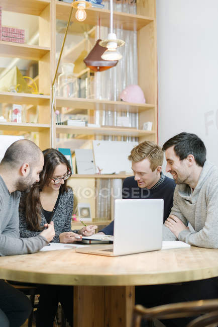 Architects discussing at office, focus on foreground — Stock Photo
