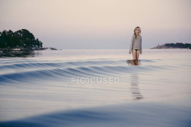 Girl standing in water, baltic sea — Stock Photo