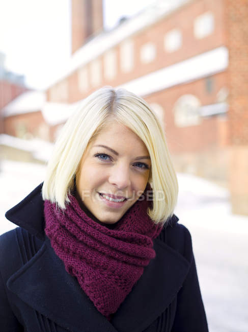 Portrait of blonde woman wearing warm clothing — Stock Photo