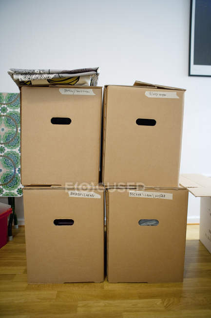 Front view of cardboard boxes stacked in room — Stock Photo