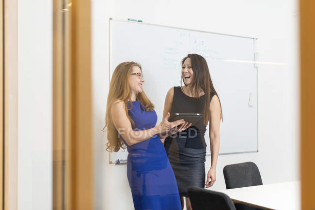 Businesswomen talking at conference room, selective focus — Stock Photo
