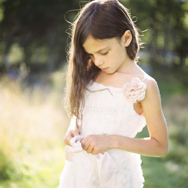 Portrait of girl in white dress, selective focus — Stock Photo
