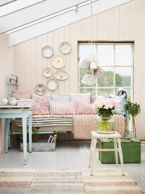Pastel colored interior of country home bedroom — Stock Photo