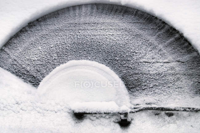 Close-up of windshield wiper pattern in snow — Stock Photo