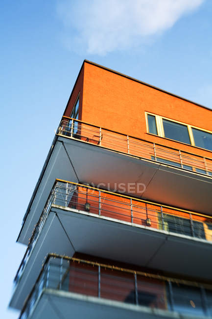 Low angle view of orange colored residential building — Stock Photo
