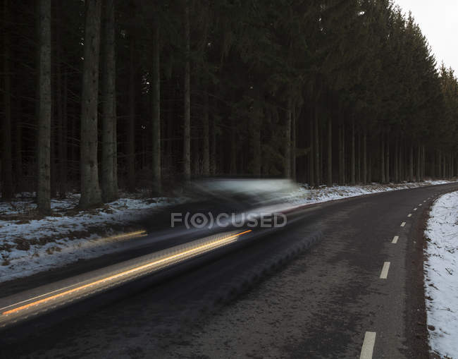 Car in fast drive speed on asphalt road — Stock Photo