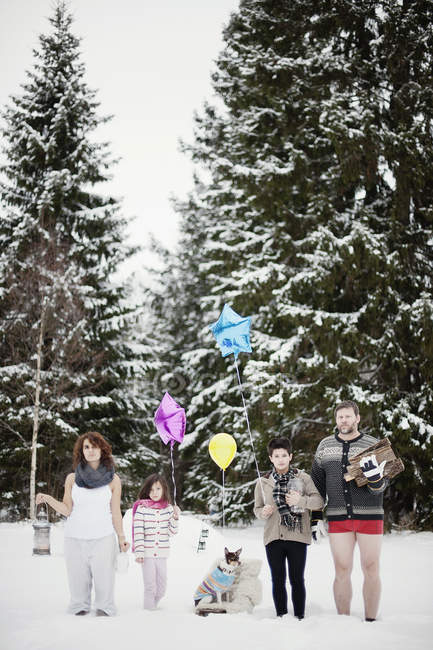 Family with two children in winter forest during christmas — Stock Photo