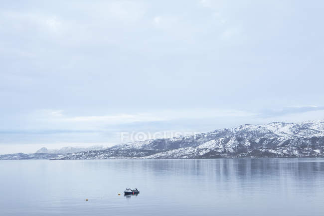 Front view of fishing boat in tidal strait — Stock Photo