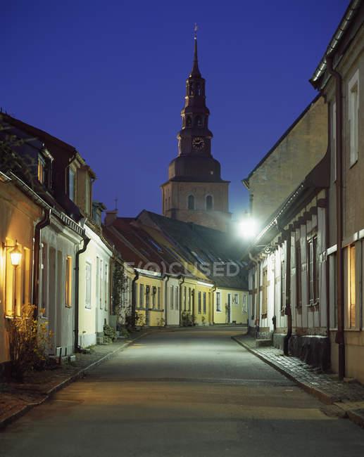 Empty old town street illuminated at night — Foto stock