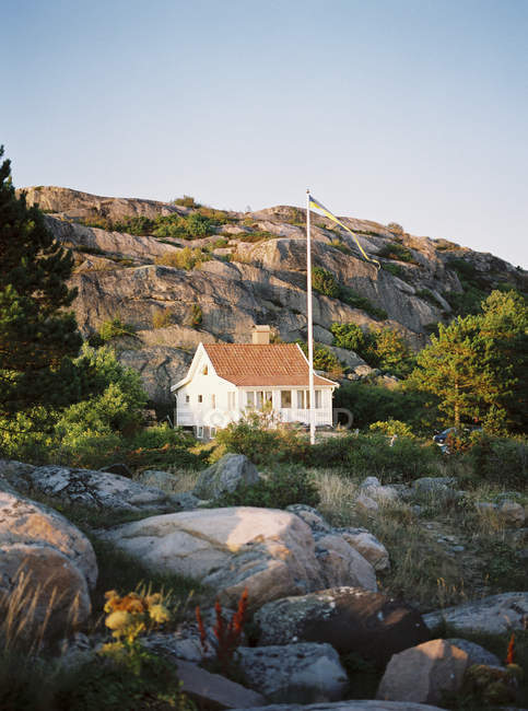 View of house on rocks in evening sunlight — Stock Photo