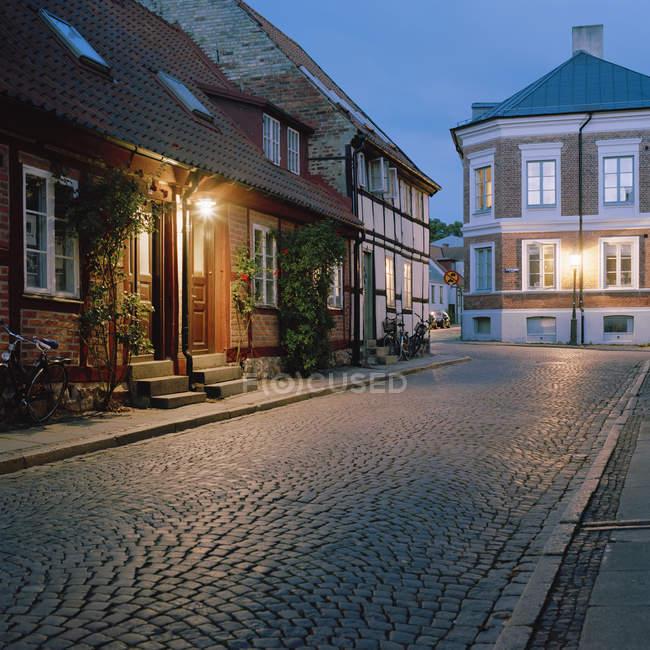 View of empty street illuminated at night — Stock Photo