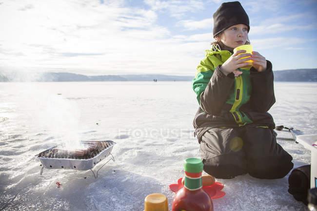 Boy drinking tea outdoors, selective focus — Stock Photo