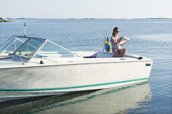 Woman sitting on sailboat, selective focus — Stock Photo
