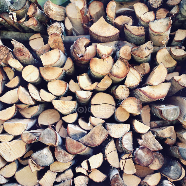 Side view of firewood pile texture — Stock Photo