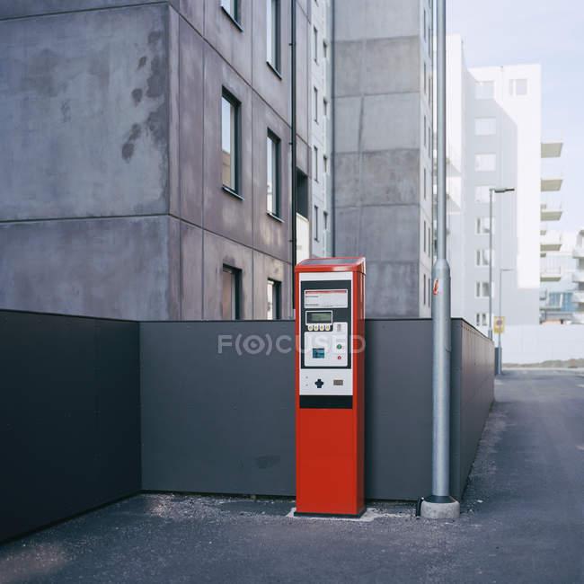 Red parking meter set on street — Stock Photo