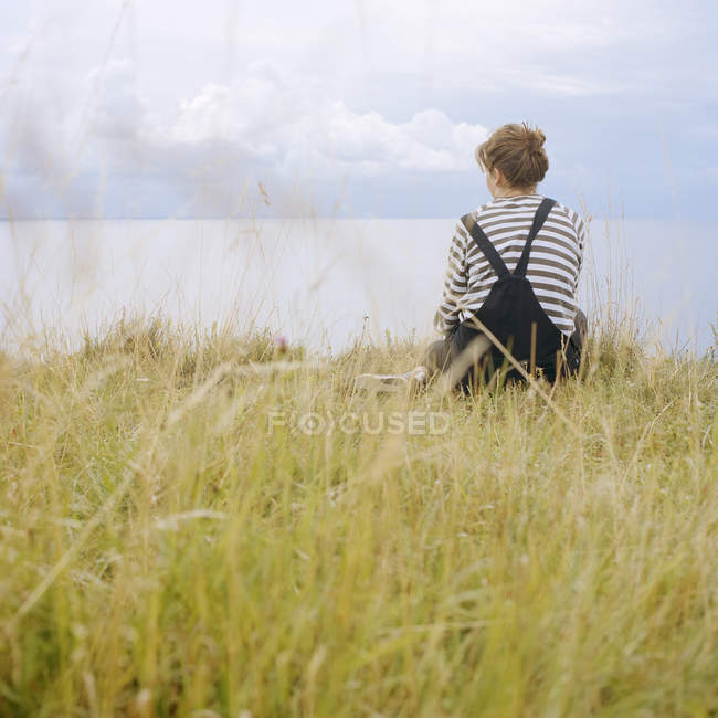Rear view of young woman looking at view — Stock Photo