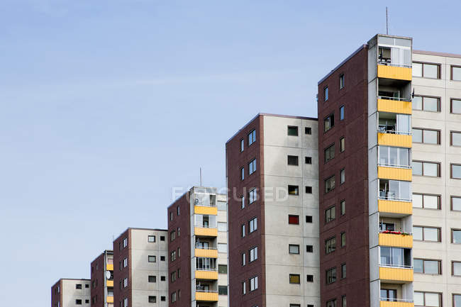 Modern flat houses facades with blue sky — Stock Photo