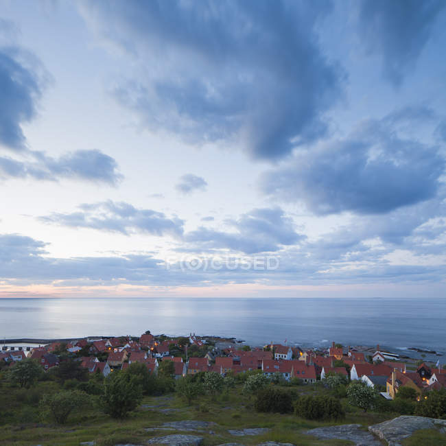 Danish townscape and sea under cloudy evening sky — Stock Photo