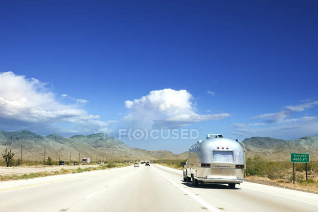 Rear view of grey campervan on road — Stock Photo