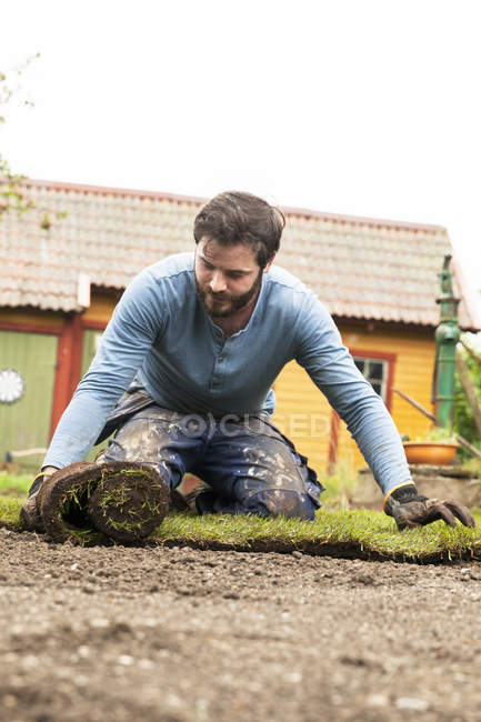 Gardener working at plant nursery — Stock Photo