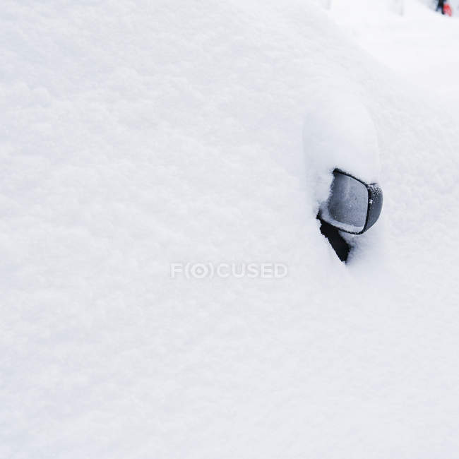 Close-up of rear mirror in snow — Stock Photo