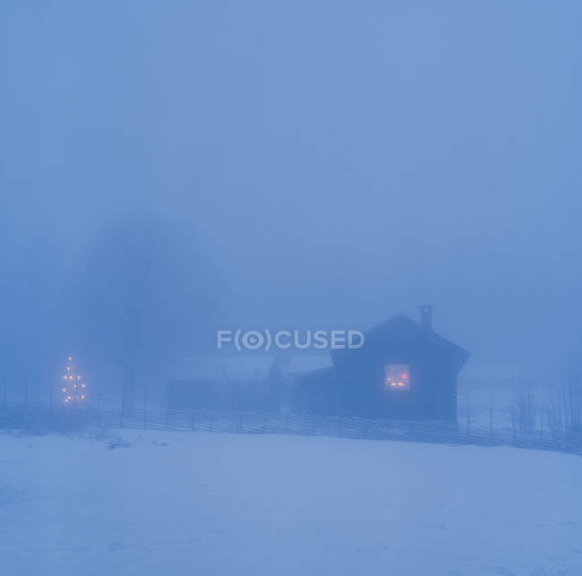 Front view of farm buildings at winter night — Stockfoto