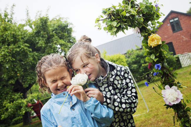 Girls smelling flowers, selective focus — Stock Photo