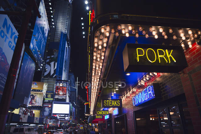 Illuminated signs on city buildings at Manhattan at night — Stock Photo