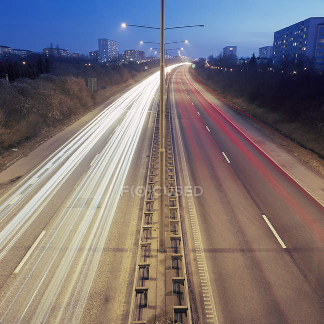 Long exposure shot of highway with light trails — Stock Photo