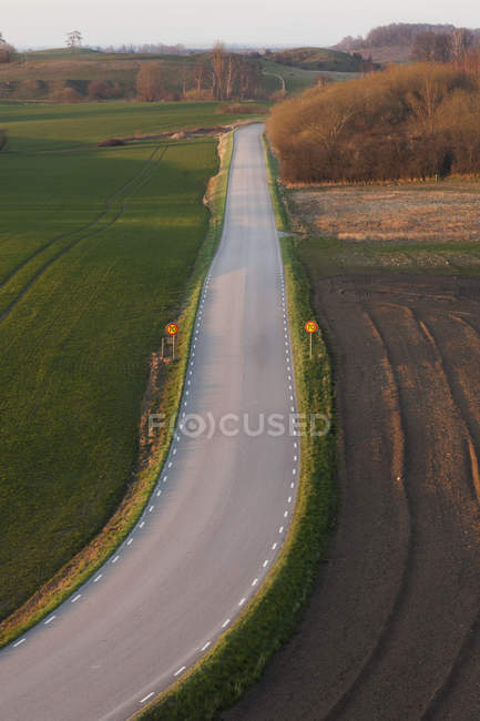 Elevated view of road in agricultural fields — Stock Photo
