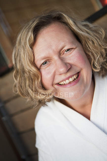 Portrait of smiling woman, focus on foreground — Stock Photo