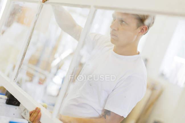 Young man renovating window, selective focus — Stock Photo
