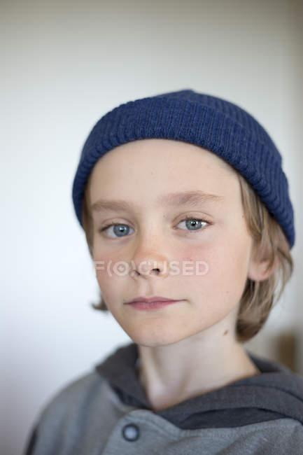 Portrait of boy wearing blue knit hat — Stock Photo