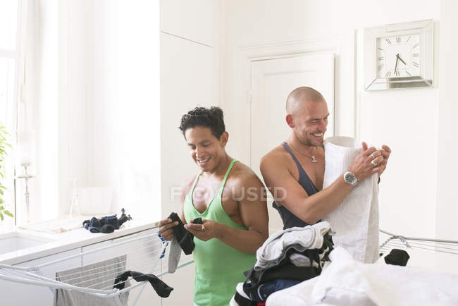 Men hanging clothes on dryer, selective focus — Stock Photo