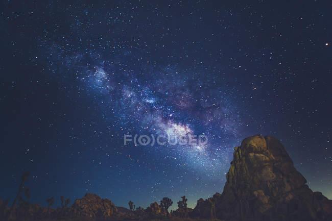Milky Way stars shining rocky mountains — Stock Photo