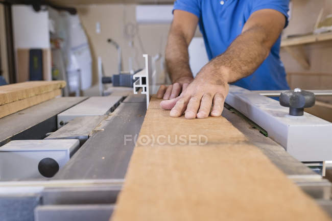 Carpenter working with wood, differential focus — Stock Photo