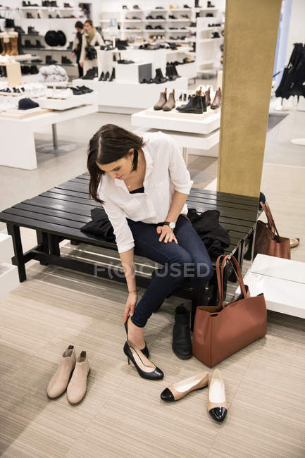 Woman trying on shoes in store, selective focus — Stock Photo